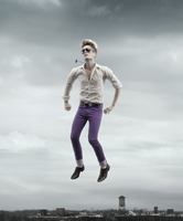 Hipster jumps in the air