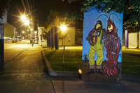 Street scene at night with fisherman and lobster photo cut out.