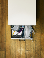 Running sneakers stuffed into an office filing cabinet