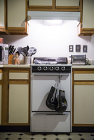 Boxing gloves hanging from oven handle