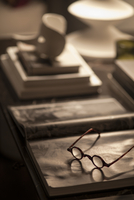 Glasses resting on books on table