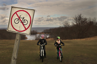 No biking Sign with Two Bikers.