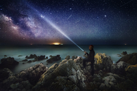 milky way with rocks and a man