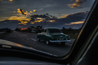 Sunset drive to Pinar Del Rio in a classic car, looking at a classic car.