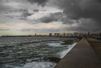 Dark clouds roll over Havana. Looking down the Malecon seawall and Havana coastline.