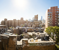 View on rooftops and graffiti in Downtown New York