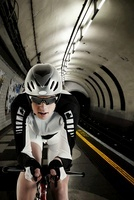 Cyclist cycling in London Underground tunnel