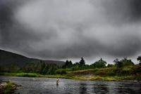 Fly fisherman in Margaree River, Nova Scotia