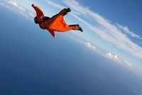 Wingsuit flying over north shore of Oahu, Hawaii