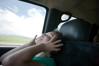 Boy listening to music in car