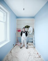 Painter and decorator wearing overalls