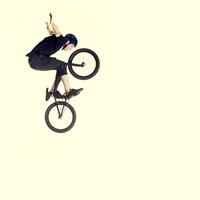 Young man on bmx bike, mid air