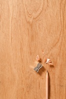 Pencil and sharpener on wooden background
