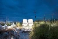 Illuminated beach chairs on sand dune, Baltic Sea, Germany