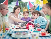 Girl with family at birthday party