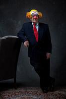 Portrait of a senior businessman in a clown mask