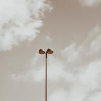 Street light against a partly cloudy sky