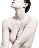 Nude woman with liquid droplets on skin