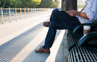 Man waiting on bench at railway station