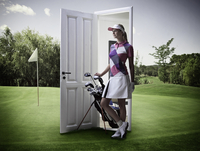 Woman emerging from door on golf course