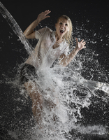 Businesswoman splashed with water 20056006496| 写真素材・ストックフォト・画像・イラスト素材|アマナイメージズ