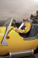 Older man driving custom car