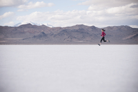 Woman running in desert landscape
