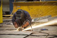 Steel cutter at work in shipyard