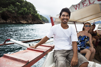 Man on tour boat in tropical waters