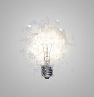 Close up of light bulb shattering