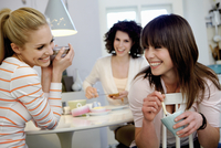 Women having coffee together at table