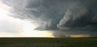 Violent outflow winds from a high precipitation supercell demonstrate a dramatic gust front on the leading edge of the outflow,