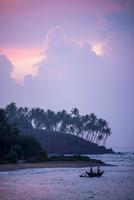 Mirissa Beach, traditional Sri Lankan outrigger fishing boat at sunrise, South Coast, Southern Province, Sri Lanka, Asia