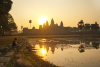 Tourist watching sunrise at Angkor Wat Temple, Angkor Temples, UNESCO World Heritage Site, Siem Reap Province, Cambodia, Indochi