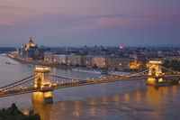 Panorama of the city at sunset with the Hungarian Parliament building, and the Chain bridge (Szechenyi Lanchid), over the River