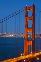 The Golden Gate Bridge, linking the city of San Francisco with Marin County, taken from the Marin Headlands at night with the ci