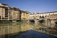 Reflections in the Arno River of the Ponte Vecchio, Florence, Tuscany, Italy, Europe