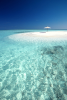 Tropical sandbank and sun umbrella, Maldives, Indian Ocean, Asia