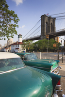 Two 1950's cars parked near the Brooklyn Bridge at Fulton Ferry Landing, Brooklyn, New York City, New York, United States of Ame