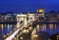 Chain Bridge and St. Stephen's Basilica at dusk, UNESCO World Heritage Site, Budapest, Hungary, Europe
