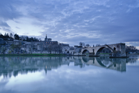 Saint-Benezet bridge dating from the 12th century, and the Palais des Papes, UNESCO World Heritage Site, across the Rhone river,