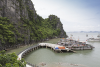 A boat docking station at one of the many isalnds in Ha Long Bay, UNESCO World Heritage Site, Vietnam, Indochina, Southeast Asia