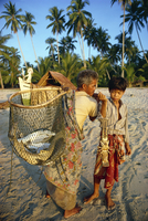 Fisherman with wicker basket and boy with shellfish, their morning catch, at Kemamaiy, east Malaysia, Southeast Asia, Asia
