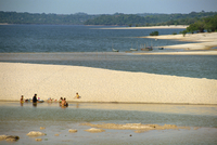 Groups of people and boats on the sand spit beaches at Alter do Chao on the Tapajos River in the Amazon area of Brazil, South Am