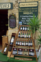 Display of wine bottles outside a shop at St. Emilion in the Gironde, Aquitaine, France, Europe