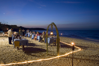 Guests dining at dusk on the Playa Esmeralda in front of the Hotel Melia Rio de Oro, Carretera Guardalavaca, Eastern Cuba, Cuba,