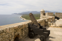 Cuban coastline and the Castillo del Morro, a fortess at the entrance to the Bay of Santiago, UNESCO World Heritage Site, 10 km
