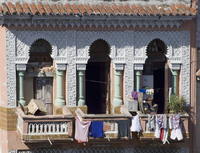 Laundry hanging from the balcony of an ornate Moorish style building in central Havana, Cuba, West Indies, Central America
