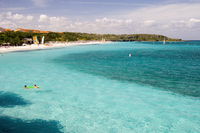 Swimmers in aqua seas, Playa Esmeralda, Carretera Guardalavarca, Cuba, West Indies, Central America