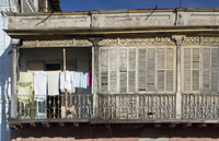 Laundry and wooden shutters on a balcony, Santiago de Cuba, Cuba, West Indies, Central America